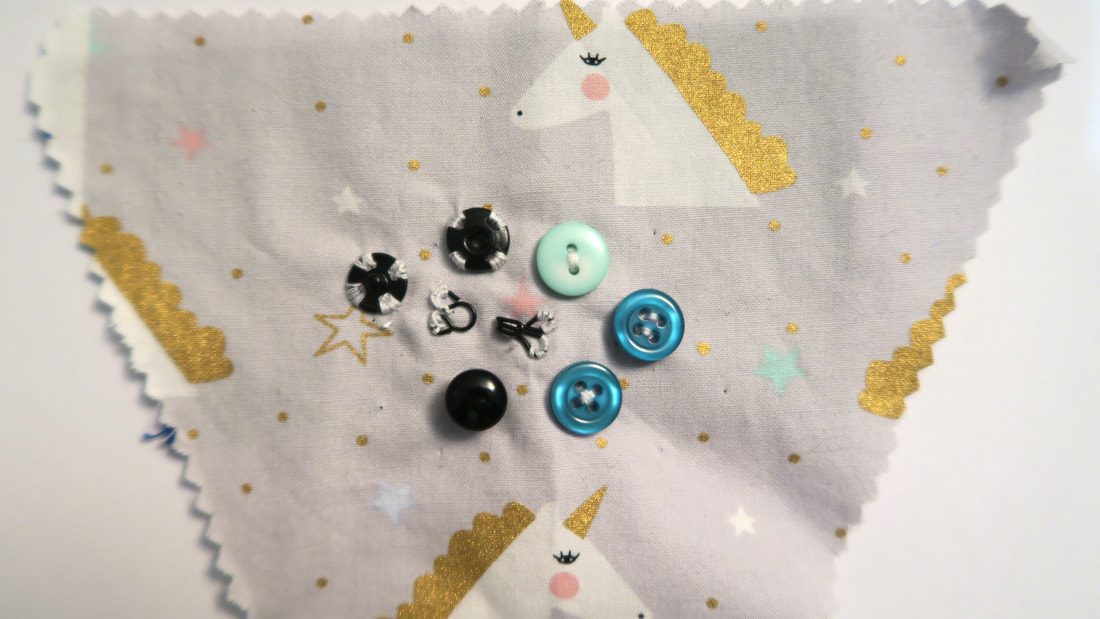 Fastenings (press studs, buttons, and hook and eye) on unicorn fabric